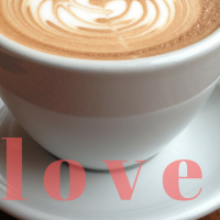 white coffee cup with swirled foam and word love
