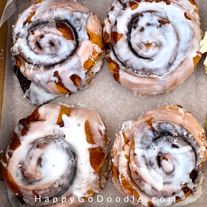 Four white frosted cinnamon rolls from Lighthouse Bakery at Dauphin Island, photo