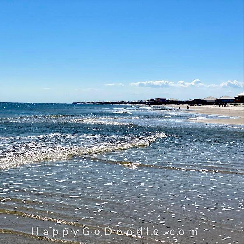 Sparkling waves and beach houses along the Gulf coast shoreline of Dauphin Island, photo